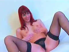 Leggy red haired slut in stockings opens her pussy curtains