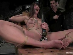 Bobbi Starr is tied up and seated on that huge dildo