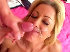 Mature blonde with huge tits gets fucked on the bed
