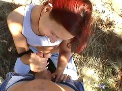 Red haired hilarious nympho Misty provides a lucky dude with a handjob