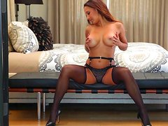 Busty pornstar in black lingerie presents her amazing body