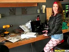 Cocky Desiree gets fucked rough in a garage neat a bike