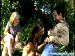 Aaralyn and Tiffany give hot blowjob to two dudes in a park