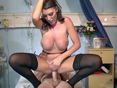 Curly-haired brunette being drilled by doctor