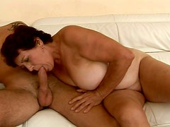 Frightful ugly old bitch gets her mature cunt fucked from behind on sofa