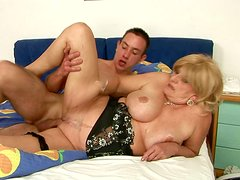 Busty mature woman gets her pussy fucked in sideways position