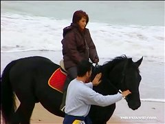 Redhead Chick Rides Horse and Gets Fucked by a Dude's Dick at the Beach