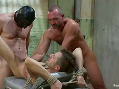 Handsome gay gets his ass stuffed with big anal balls in BDSM scene