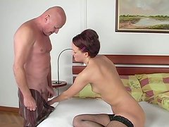Young whore gives an old man a nice blowjob in 69 pose