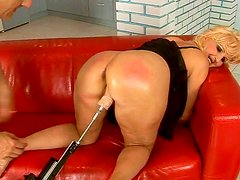 Fat assed mature woman is fucked doggy style with sex machine