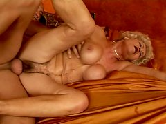 Bizarre granny with hairy pussy  is getting banged hard doggy style