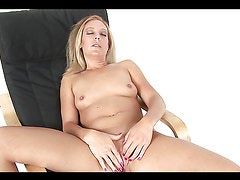Charli Shay masturbates while sitting on a chair
