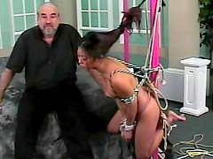 Asian babe in BDSM porn