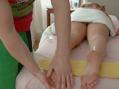 Masseur guy finger fucks shaved alluring pussy of one sweet cutie