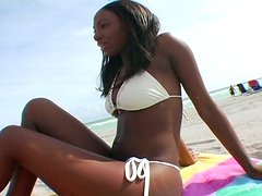 Booty ebony bitch wearing white bikini wants something special