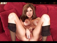Busty whore sticks a hard toy in her pussy
