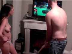 Couple plays Wii Golf and fools around