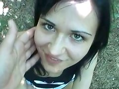 Brunette with charming eyes gives blowjob outdoor