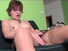 Milf in stockings sensually rubs her pussy