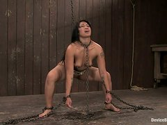Asian siren is chained and she tires to get out so bad