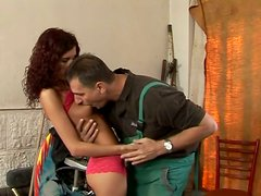 Brunette temptress gives horny repairman a nice blowjob