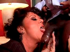 Spoiled brunette mom gives a head to strain black penis of hotel waiter