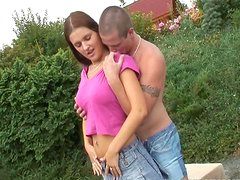 Young busty Claire 69ing outdoors