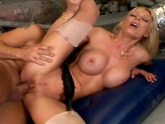 Hardcore blonde with fake boobies is riding on the cock