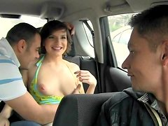 Brunette shows her tits in the car and gets fucked