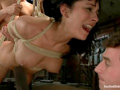 Sexy brunette gets bound and fucked hard by two lewd dudes