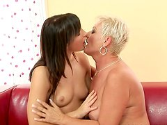 Old and young lesbians kiss and tease each other passionately