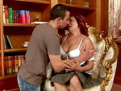 Red haired mature harlot has sex fun with young handsome dude