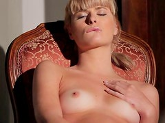 Tasty looking blond hottie caresses her bald vagina in solo sex clip