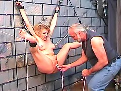 Curvy collared blonde abused in dungeon