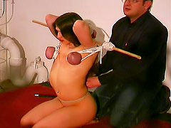 Tits tied and tortured in hot video