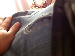 rubbing her soft pussy outside her jeans then inside