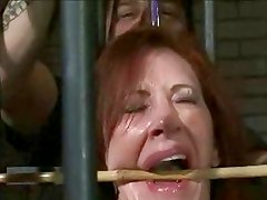 redhead milf caged teaser