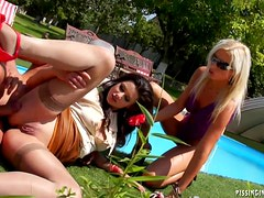 Two clothed girls covered in piss