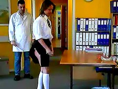 Schoolgirl bends over for a caning