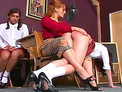 Redheaded school mistress spanks students