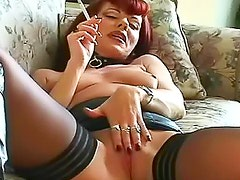 Redhead in leather smokes for you
