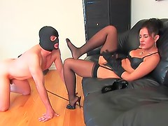 Mistress gives handjob and demands foot worship