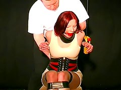 Kinky latex bondage girl gagged