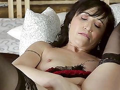 Naughty housewife teasing herself on her bed