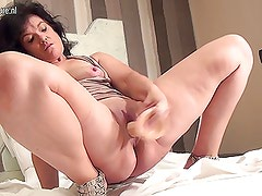 Amateur old mother getting ready with her dildo