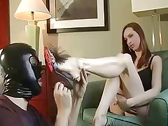 Slave Sniffs and Worships Redhead's Feet