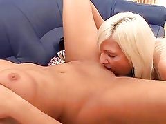 Amateur lesbians licking pussies at the couch