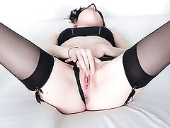 Amateur girl masturbating in black stockings