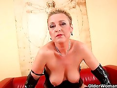 Kinky grandma in stockings fucks a dildo