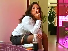 Business beauty smokes sensually